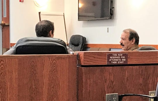 Edmond Christopher Staley consults with his attorney Clayton E. Crowley prior to  a temporary restraining order hearing Monday, Oct. 7 in 12th Judicial District Court.