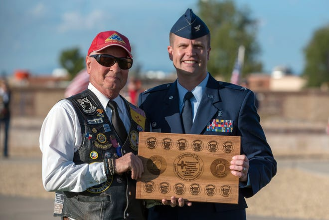 Deacon Jim Ernst, Patriot Guard Riding Club New Mexico State captain, receives a plaque from Col. John Davis, 49th Medical Group commander, during a POW/MIA Remembrance Ceremony on Holloman Air Force Base, N.M., Sept. 20, 2019. There are currently 12 unaccounted for New Mexican prisoners of war and missing in action military members.