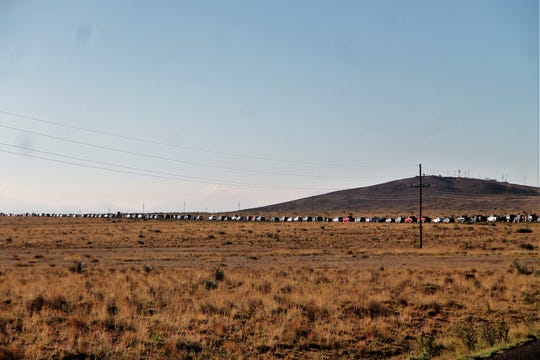 A line of cars wait to enter Stallion Gate at White Sands Missile Range on Oct. 5. White Sands Missile Range held its biannual Trinity Site Open House Saturday, Oct. 5. The event drew a large crowd trying to get in and a group of protesters from the Tularosa Basin Downwinders Consortium.