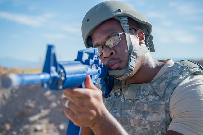 Senior Airman William Robinson, Electrical Systems Journeyman, scans the area with an M16 training rifle, on Holloman Air Force Base, N.M, Sept. 12, 2019. During their training, the 49th CES built small shelter systems and spent the night at a training site on base, practicing integrated defense, defensive fighting positions and individual movement techniques.