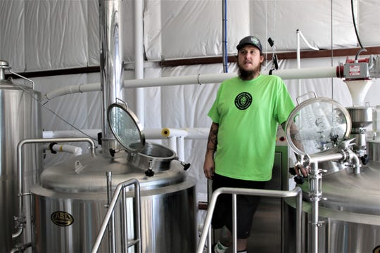 Owner Brandon Beard takes a moment to relax in the brewery at the Lauter Haus Brewing Company in Farmington.