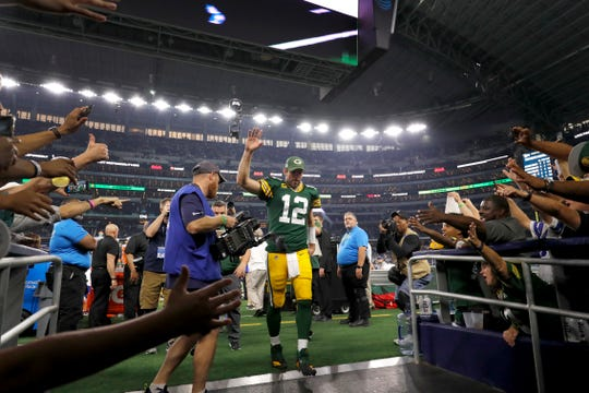 Green Bay Packers' Aaron Rodgers acknowledges fans as he walks off the field after the team's NFL football game against the Dallas Cowboys in Arlington, Texas, Sunday, Oct. 6, 2019.