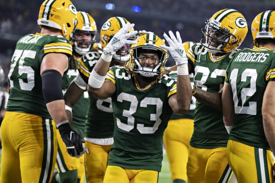 ARLINGTON, TX - OCTOBER 6: Aaron Jones #33 of the Green Bay Packers celebrates after scoring his fourth touchdown during a game against the Dallas Cowboys at AT&T Stadium on October 6, 2019 in Arlington, Texas.   (Photo by Wesley Hitt/Getty Images)