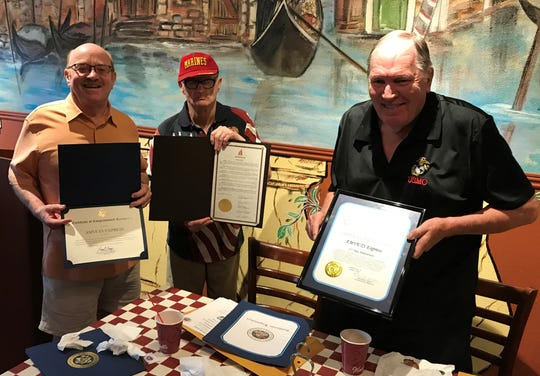 Volunteer driver Brian Barger and AMVETS Post 66 administrators Tom Swann Hernandez and Charlie Sharples hold commendations for the 15th anniversary of the AMVETS Express transportation service.
