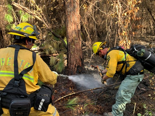 Firefighters from the Florida Forest Service are back on scene of the 3-acre East Bay Fire in south Santa Rosa County Monday morning continuing the mop-up process.
