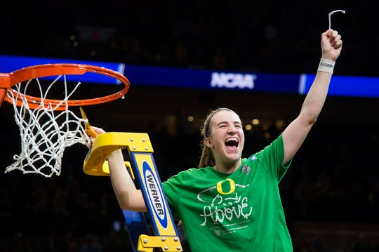 Sabrina Ionescu cuts down the net after Oregon beat Mississippi State to reach the 2019 Final Four.