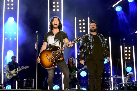 Dan Smyers and Shay Mooney of Dan + Shay perform at the 2019 CMA Music Festival on June 07, 2019 in Nashville, Tennessee.