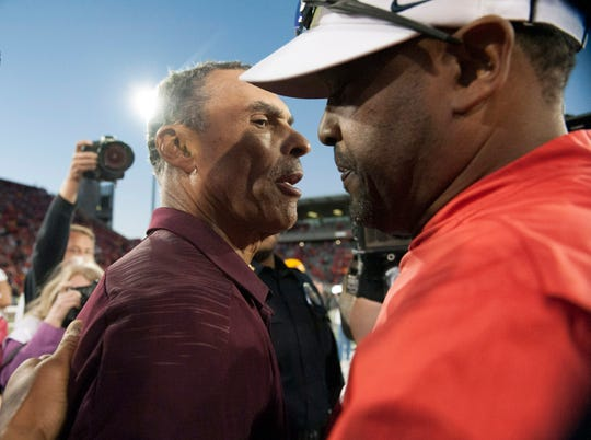 Arizona State Sun Devils head coach Herm Edwards (left) and Arizona Wildcats head coach Kevin Sumlin shake hands after the Territorial Cup at Arizona Stadium last season. The coaches have both of their teams off to 4-1 starts this season.