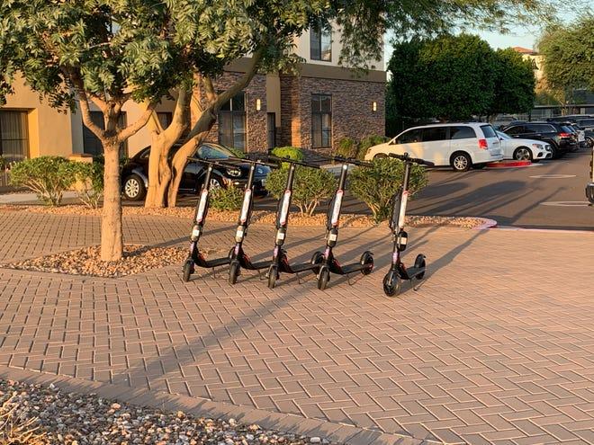 Scooters near the hotels on Bullard Avenue in Surprise last month.