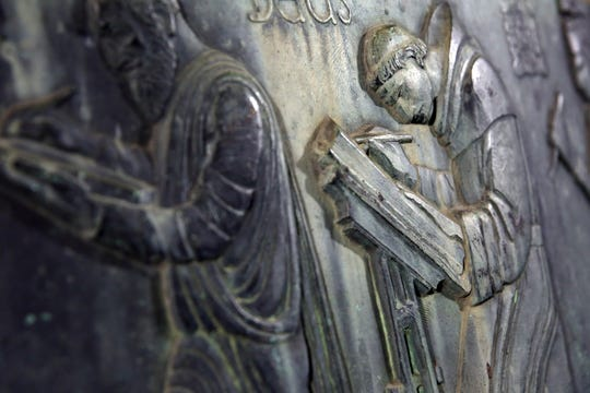 """A detail of a bronze sculpture titled """"Well of the Scribes,"""" is seen during an unveiling of the long-lost sculpture after been discovered in Arizona, on Friday, Oct. 4, 2019 at the Central Library in Los Angeles."""