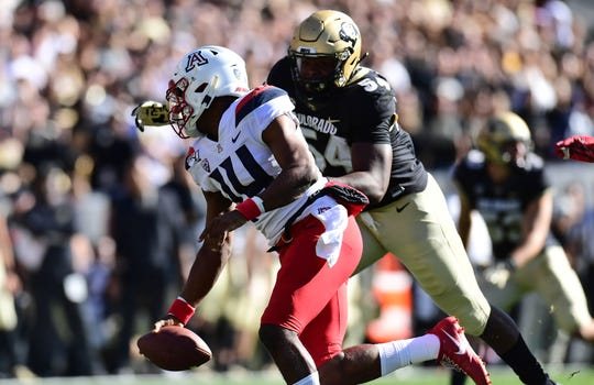Arizona Wildcats quarterback Khalil Tate (14) is pressured by Colorado Buffaloes defensive end Terrance Lang (54) in the first quarter at Folsom Field.