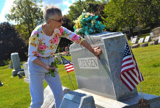 Maria Moon cleans the grave of Harry B. Stensen, whose generosity was the basis for the Harry B. Stensen Foundation which helps fund the Port Clinton Friends of the Cemetery group as well as many other charitable causes in Ottawa County. Moon said her gratitude inspires to take special care of Stensen's grave.