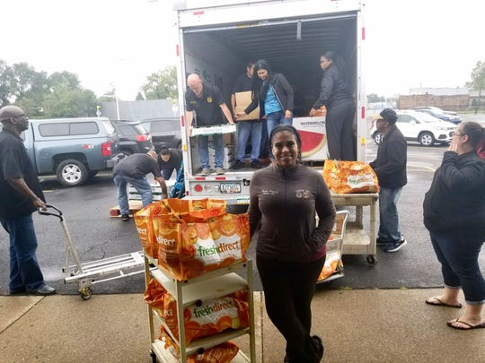 United Auto Workers union members load food at the Sos Marysville Food Pantry to take to General Motors employees on strike on Oct. 3, 2019.