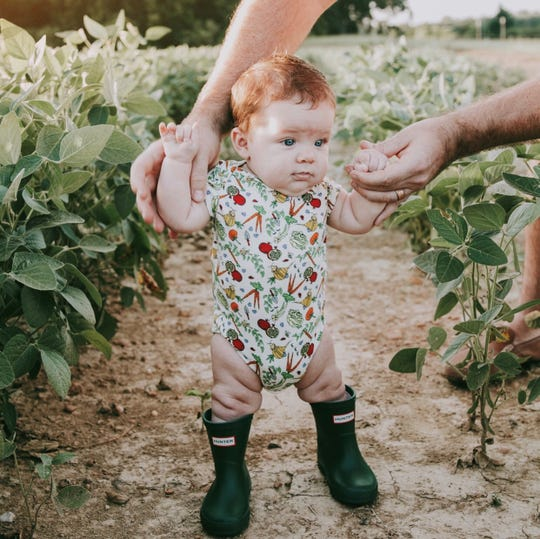 The Veggie Garden Onesie by Lucky Bug Clothing Company.