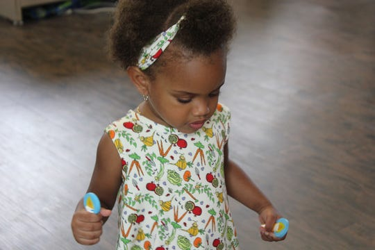 The Veggie Garden Dress and Headband by Lucky Bug Clothing Company, which is based in Gardiner.