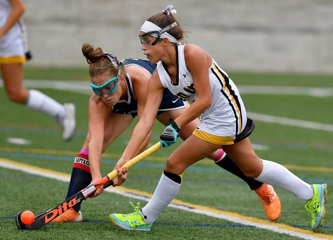 New Oxford's Alysia Kraus, left, attempts to knock the ball away from Hannah Downs of Red Lion, Monday, October 7, 2019. John A. Pavoncello photo