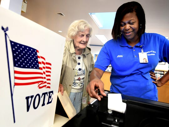 Myrna Hyson-Ross, 95, of Shrewsbury Township, is shown the new voting process by Nikki Suchanic, the director of elections and voter registration in York County, during a voting machine demonstration at Paul Smith Library of Southern York County Monday, Oct. 7, 2019. York County voters will be using a paper ballot in upcoming elections. Bill Kalina photo