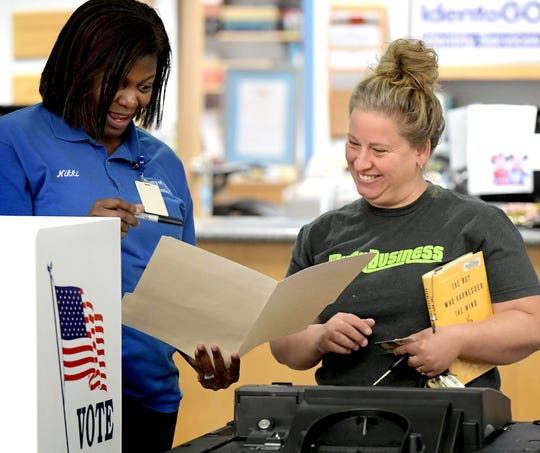 Nikki Suchanic, the director of elections and voter registration in York County, talks with Tiffany Counts of New Freedom during a voting machine demonstration at Paul Smith Library of Southern York County Monday, Oct. 7, 2019. York County voters will be using a paper ballot in upcoming elections. Bill Kalina photo