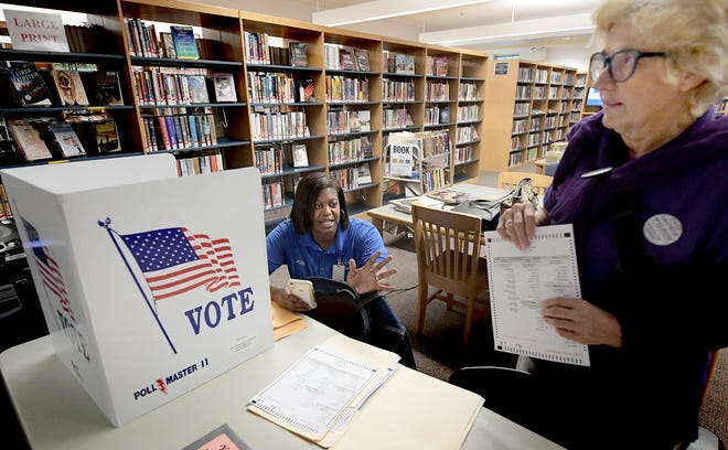 Shrewsbury Township supervisor candidate Jackie Wilson talks with Nikki Suchanic, the director of elections and voter registration in York County, left, during a voting machine demonstration at Paul Smith Library of Southern York County Monday, Oct. 7, 2019. York County voters will be using a paper ballot in upcoming elections. Bill Kalina photo