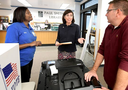 Nikki Suchanic, the director of elections and voter registration in York County, left, talks with state Sen. Kristin Phillips-Hill and Tom Metz, Philips-Hill's district office coordinator, during a voting machine demonstration at Paul Smith Library of Southern York County Monday, Oct. 7, 2019. York County voters will be using a paper ballot in upcoming elections. Bill Kalina photo