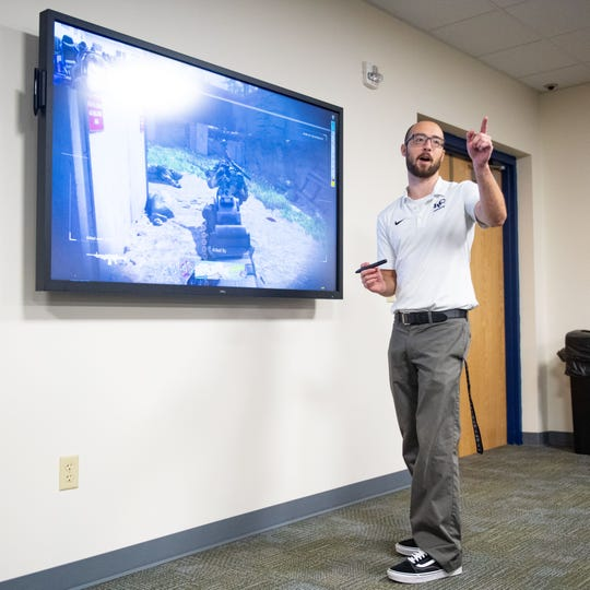 LVC head coach Joe D'Angelo uses a smart TV to go over athletes' gameplay and talk strategy, August 23, 2019.