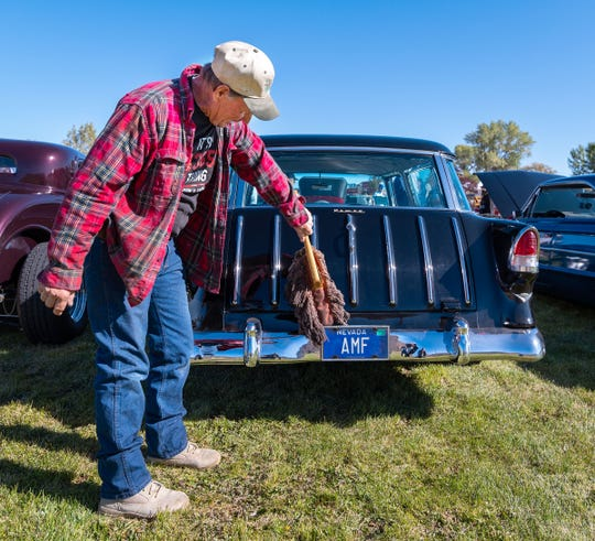 Alan Chichester, of Coleville, wipes down his 1955 Chevrolet Nomad.