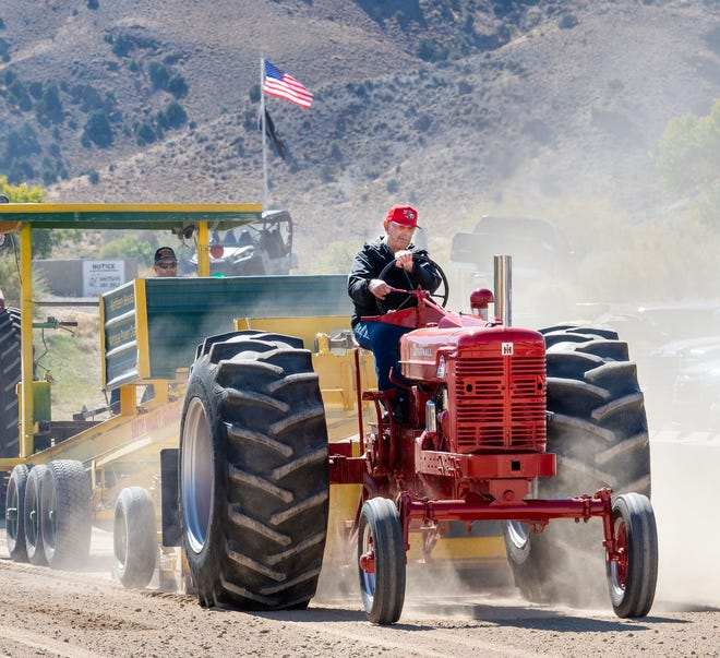 An antique Farmall tractor pulls the sled in the tractor pull competition.