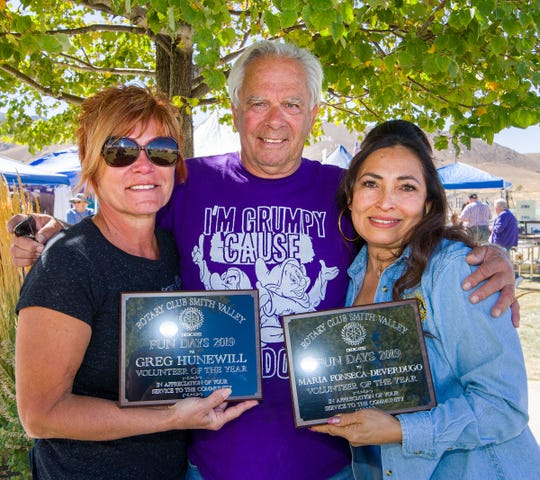Steve Bohler, center, President of Rotary Club of Smith Valley, presents Volunteer of the Year awards to Lorie McMahon, left, who accepted the award on behalf of former county commissioner Greg Hunewill, who died earlier this year, and Maria (Rosie) Fonseca-Deverdugo.