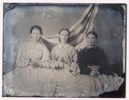 A daguerreotype shows women in the mid-19th century.