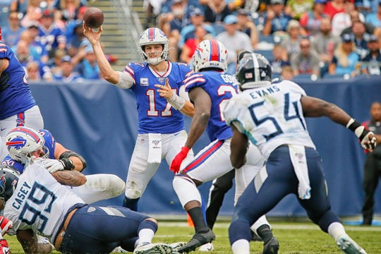 Quarterback Josh Allen of the Buffalo Bills throws a pass to Frank Gore during the first half of Sunday's game in Nashville.