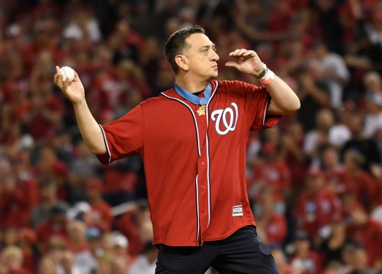 Medal of Honor recipient David Bellavia throws a ceremonial first pitch before Game 3 of a baseball National League Division Series between the Los Angeles Dodgers and the Washington Nationals, Sunday, Oct. 6, 2019, in Washington.