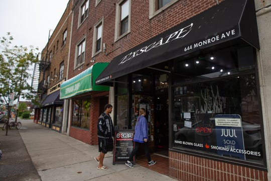 Patrons enter Exscape Smoke Shop and Vape Lounge on Monroe Avenue in downtown Rochester. Monday, Oct. 7, 2019.