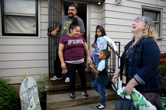 Martin Carbajal, 6, a first grader at Hoover Elementary School, gets a home visit from his teacher, Katrina Ohlemiller, right, with his parents, Sonya and Martin, and sister, Barbie, 8, at their Salem home on Oct. 4, 2019.