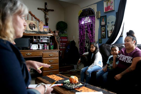 Martin Carbajal, 6, a first grader at Hoover Elementary School, gets a home visit from his teacher, Katrina Ohlemiller, while sitting with his sister, Barbie, 8, and mom, Sonya, in their Salem home on Oct. 4, 2019.