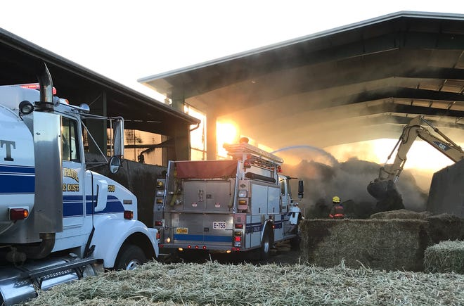 A barn fire burned stored hay at a St. Paul area dairy Sunday, October 7, 2019.