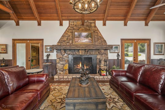 The great room features a massive stone fireplace.