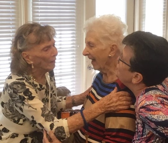 Birthday girl Mary Leverette (far left) greets Juanita Bickham and Melinda Vaught at her 100th birthday fete.