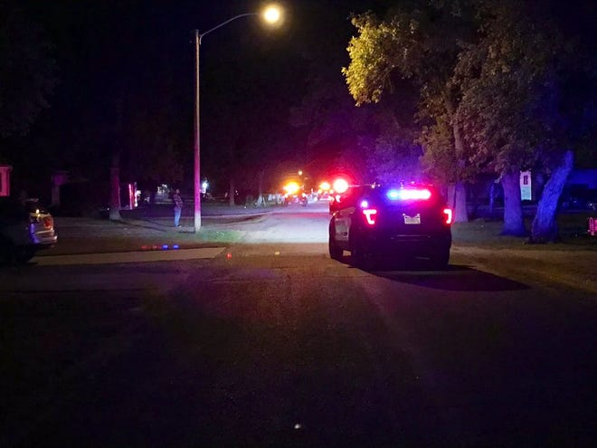 Authorities are shown on scene after a shooting in the 3500 block of N. Sixth Avenue in Sioux Falls on Sunday night.