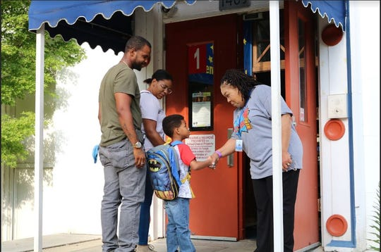 Angela Holloway Payne, the new principal at Boyd Elementary, greets families at the front door of the historic school.