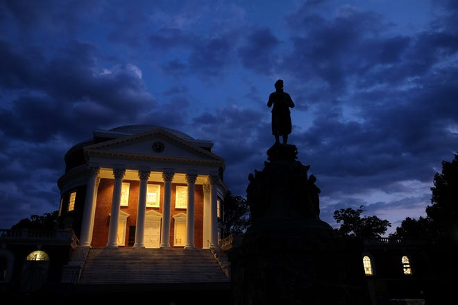 A statue of Thomas Jefferson stands in front of the Rotunda at the University of Virginia.