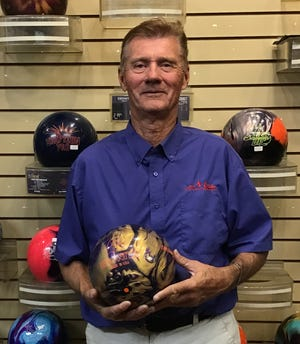 "Dave Mave poses with his ""Storm Rocket Ship"" bowling ball after throwing his second 300 game at the Virgin River Bowling Center in Mesquite."