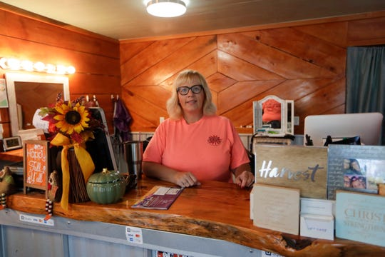 Christy Manning, owner of Talk of the Town barber and beauty shop in Malone, has seen her business change in the past year since Hurricane Michael hit the rural community.