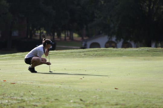 Chiles golfer Sabree Lefebvre lines up for a putt during the girls golf Big Bend Championship at Killearn Country Club Monday, Oct. 7, 2019.