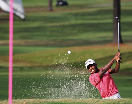 Leon senior Marquis Taylor hits out of a bunker during the boys golf City Championships at Hilaman Golf Course on Monday, Oct. 7, 2019.