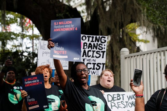 Protestors marched from the U.S. District Courthouse to First Presbyterian Church, rallying in support of Amendment 4 and against qualifications the legislature has included in the implementation of the law Monday, Oct. 7, 2019.
