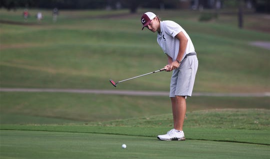 Chiles sophomore Parker Bell watches a punt during the boys golf City Championships at Hilaman Golf Course on Monday, Oct. 7, 2019.