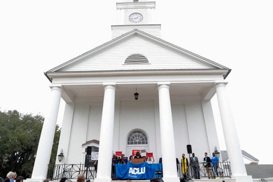 ACLU Deputy Director Melba Pearson speaks to a crowd of protestors who rallied at First Presbyterian Church in support of Amendment 4 and against qualifications the legislature has included in the implementation of the law Monday, Oct. 7, 2019.