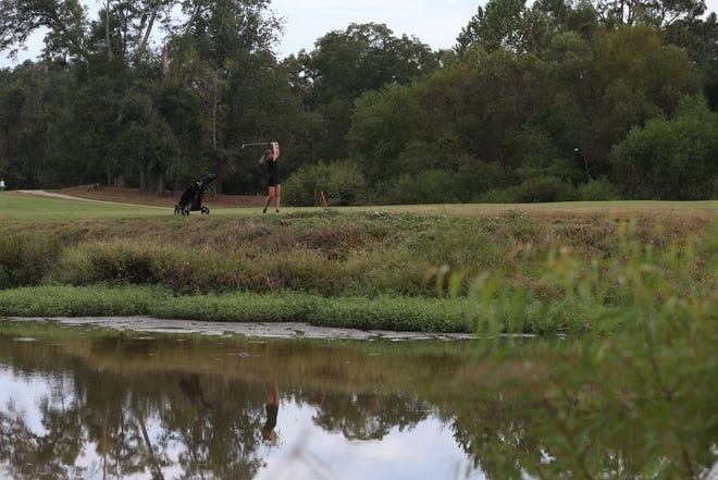 Florida High golfer Emma Conrad hits a shot during the girls golf Big Bend Championship at Killearn Country Club Monday, Oct. 7, 2019.