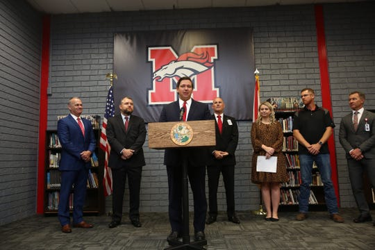 Gov. Ron DeSantis announces proposal to increase minimum salary for Florida teachers while at Middleburg High School in Clay County Oct. 7, 2019.