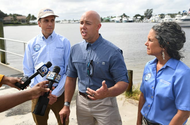 "U.S. Rep. Brian Mast (center), talks about their tour of the St. Lucie River and Indian River Lagoon on Monday, Oct. 7, 2019, along with Drew Bartlett (left) and Jacqui Thurlow-Lippisch, both of the South Florida Water Management District, at Sandsprit Park in Stuart. ""I think what we were really doing was taking a look around, talking about lessons learned"" Mast said."